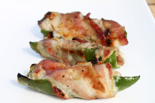 Grilled Jalapeno Peppers Stuffed with Turkey and Cheese and Wrapped in Bacon